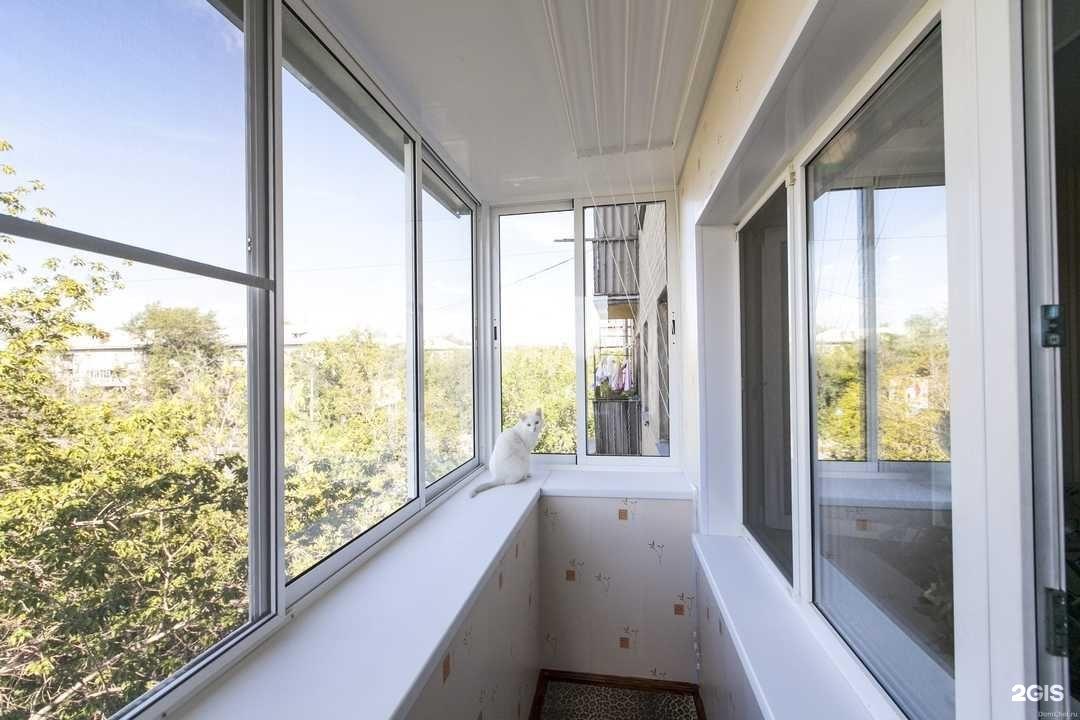 Остекление балкона раздвижными окнами с внутренней отделкой .